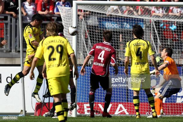 Lucas Barrios of Dortmund scores his team's first goal during the Bundesliga match between 1 FC Nuernberg and Borussia Dortmund at the Easy Credit...