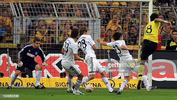 Lucas Barrios of Dortmund scores his team's opening goal during the Bundesliga match between Borussia Dortmund and FC Bayern Muenchen at the Signal...
