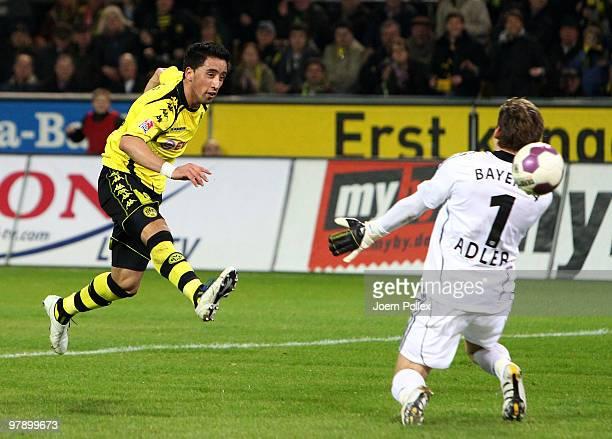 Lucas Barrios of Dortmund scores his team's second goal during the Bundesliga match between Borussia Dortmund and Bayer Leverkusen at Signal Iduna...
