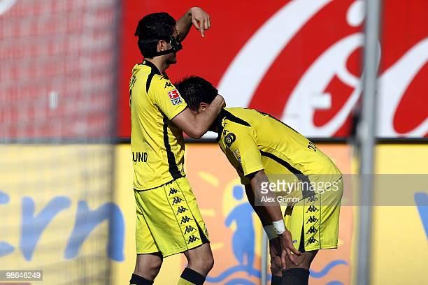 Lucas Barrios of Dortmund scores his team's third goal and celebrates with team mate Nuri Sahin during the Bundesliga match between 1 FC Nuernberg...