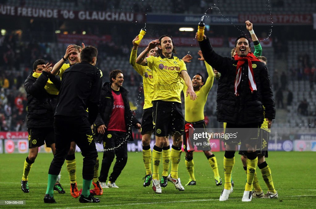 Lucas Barrios of Dortmund, who scored the first goal, (R) celebrates with team mates after winning the Bundesliga match between FC Bayern Muenchen and Borussia Dortmund at Allianz Arena on February 26, 2011 in Munich, Germany.