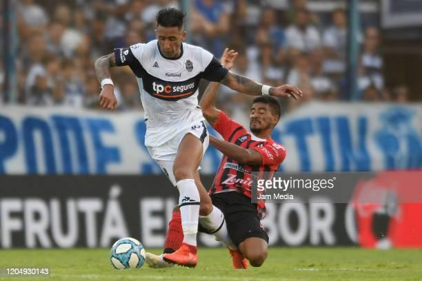 Lucas barrios of Gimnasia y Esgrima fights for the ball with Fernando Luna of Patronato during a match between Gimnasia y Esgrima La Plata and...