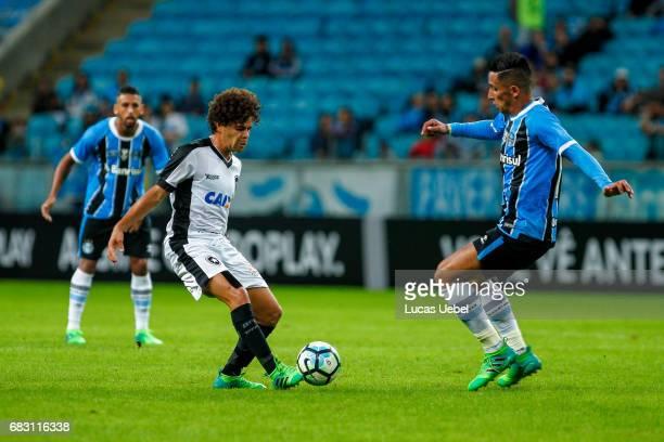 Lucas Barrios of Gremio battles for the ball against Camilo of Botafogo during the match Gremio v Botafogo as part of Brasileirao Series A 2017 at...