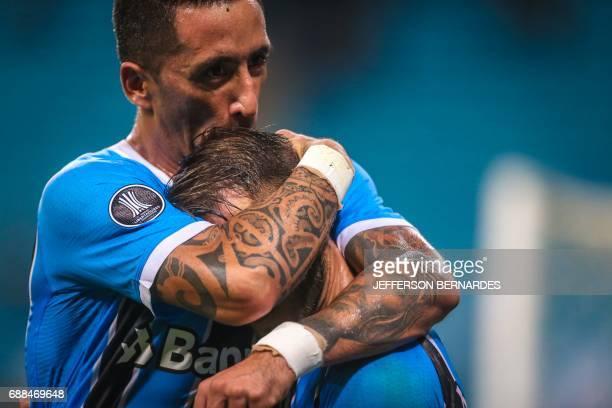 Lucas Barrios of Gremio celebrates with Gaston Fernandez after scoring against Venezuela's Zamora during their Copa Libertadores football match at...