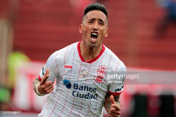 Lucas Barrios of Huracan celebrates after scoring his side's first goal during a match between Huracan and San Lorenzo as part of Superliga Argentina...