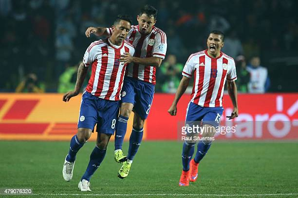 Lucas Barrios of Paraguay celebrates with teammates after scoring the first goal of his team during the 2015 Copa America Chile Semi Final match...