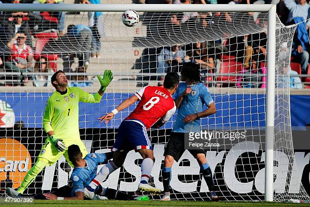 Lucas Barrios of Paraguay heads to score the first goal of his team during the 2015 Copa America Chile Group B match between Uruguay and Paraguay at...