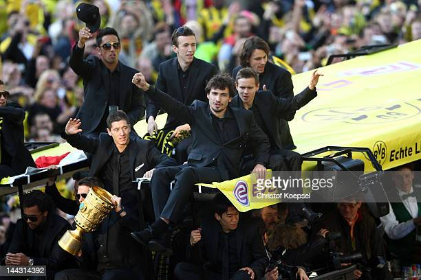 Lucas Barrios Robert Lewandowski Ivan Perisic Mats Hummels Chris Loewe and Neven Subotic of Dortmund wave to the fans during a parade at Borsigplatz...