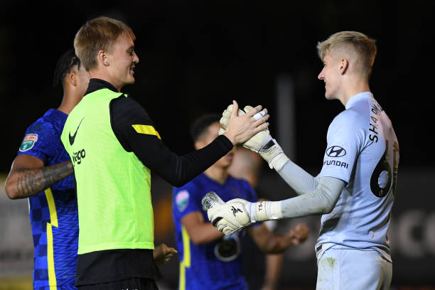 Lucas Bergstrom congratulates Ted Sharman Lowe of Chelsea after the penalty shoot out at the Exeter City v Chelsea U21 Leasing.Com Trophy match at St...