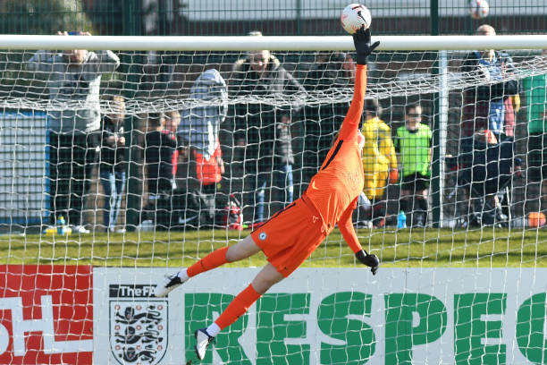 Lucas Bergstrom of Chelsea makes a save during the Blackburn Rovers v Chelsea Premier League 2 match at Leyland County Ground on May 7, 2021 in...