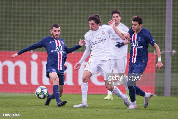 Lucas Bernadou of Paris SaintGermain Carlos Dotor Gonzalez of Real Madrid and Kays RuizAtil of Paris SaintGermain battle for the ball during the...