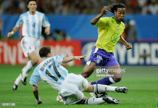 Lucas Bernardi of Argentina challenges Ronaldinho of Brazil during the FIFA 2005 Confederations Cup Final between Brazil and Argentina at the...