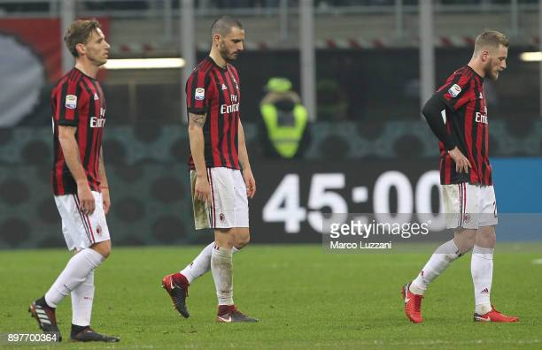 Lucas Biglia Leonardo Bonucci and Ignazio Abate of AC Milan shows their dejection at the end of the serie A match between AC Milan and Atalanta BC at...