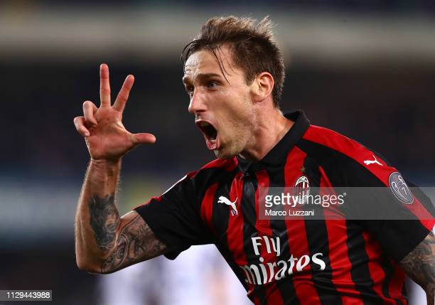 Lucas Biglia of AC Milan celebrates after scoring the opening goa during the Serie A match between Chievo Verona and AC Milan at Stadio Marc'Antonio...