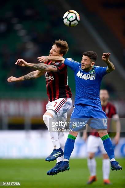 Lucas Biglia of AC Milan competes for a header with Stefano Sensi of US Sassuolo during the Serie A football match between AC Milan ad US Sassuolo...