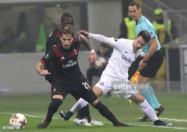 Lucas Biglia of AC Milan competes for the ball with Dominik Prokop of Austria Wien during the UEFA Europa League group D match between AC Milan and...