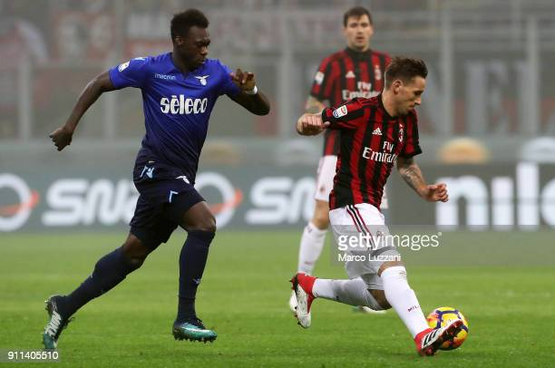 Lucas Biglia of AC Milan competes for the ball with Felipe Caicedo of SS Lazio during the serie A match between AC Milan and SS Lazio at Stadio...