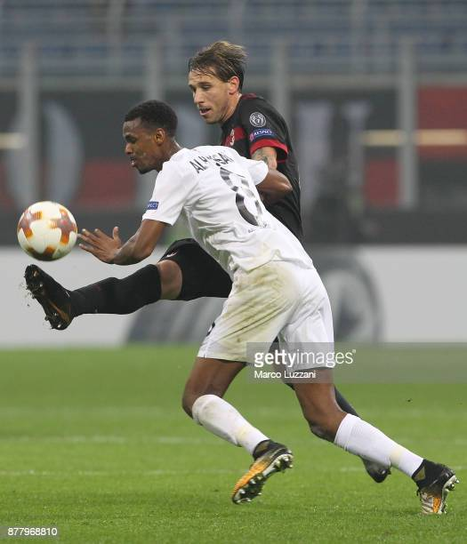 Lucas Biglia of AC Milan competes for the ball with Ibrahim Alhassan Abdullahi of Austria Wien during the UEFA Europa League group D match between AC...