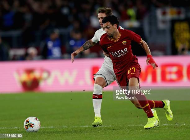Lucas Biglia of AC Milan competes for the ball with Javier Pastore of AS Roma during the Serie A match between AS Roma and AC Milan at Stadio...