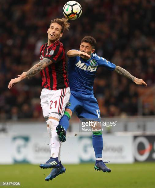 Lucas Biglia of AC Milan competes for the ball with Stefano Sensi of US Sassuolo during the serie A match between AC Milan and US Sassuolo at Stadio...