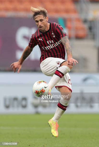 Lucas Biglia of AC Milan controls the ball during the Serie A match between AC Milan and Parma Calcio at Stadio Giuseppe Meazza on July 15, 2020 in...