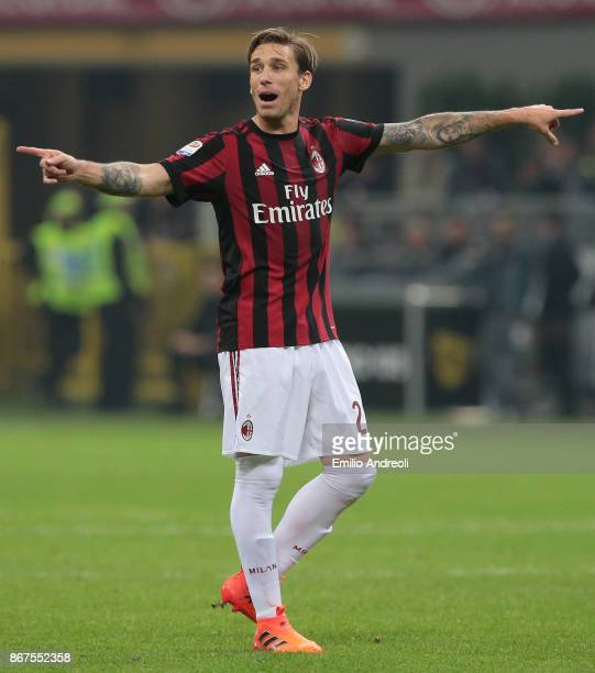 Lucas Biglia of AC Milan gestures during the Serie A match between AC Milan and Juventus at Stadio Giuseppe Meazza on October 28 2017 in Milan Italy