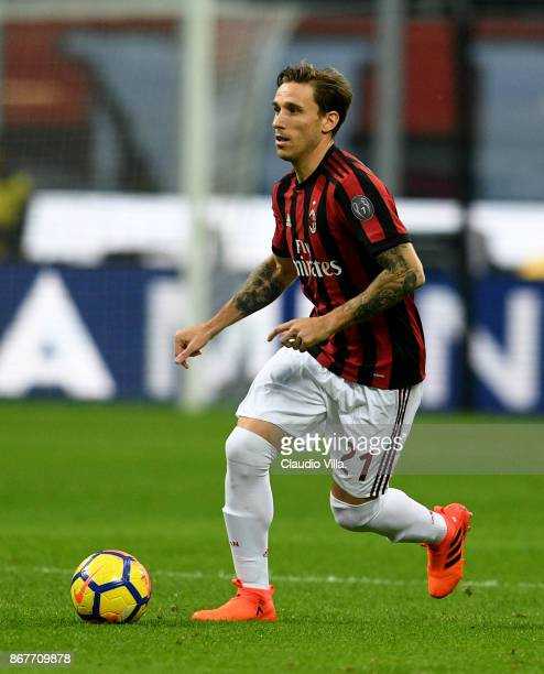 Lucas Biglia of AC Milan in action during the Serie A match between AC Milan and Juventus at Stadio Giuseppe Meazza on October 28 2017 in Milan Italy