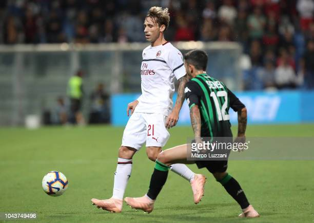 Lucas Biglia of AC Milan is challenged by Stefano Sensi of US Sassuolo during the Serie A match between US Sassuolo and AC Milan at Mapei Stadium...
