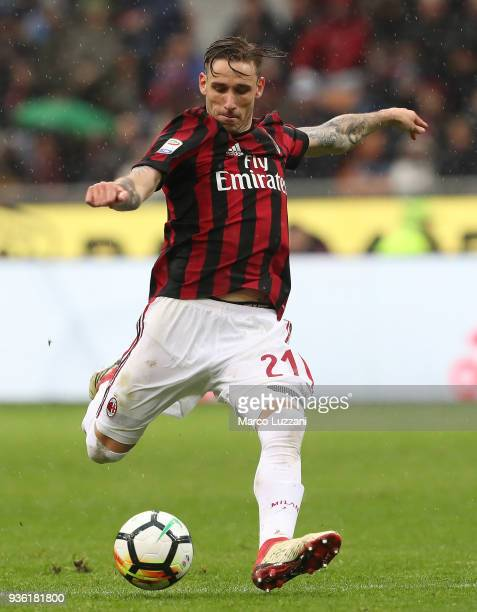 Lucas Biglia of AC Milan kicks the ball during the serie A match between AC Milan and AC Chievo Verona at Stadio Giuseppe Meazza on March 18 2018 in...
