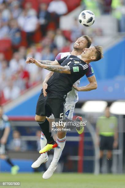 Lucas Biglia of Argentina and Kari Arnason of Iceland vie for the ball during the first half of a 11 World Cup groupstage match at Spartak Stadium in...