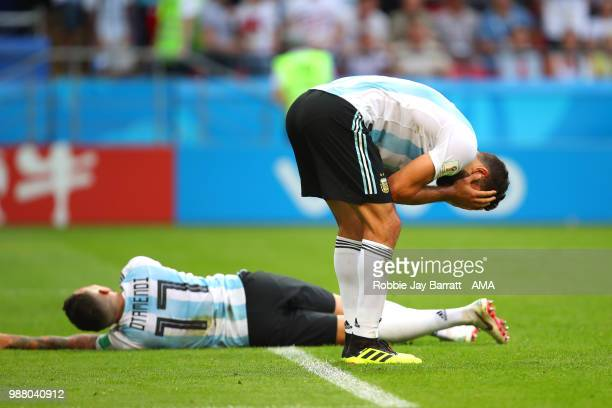 Lucas Biglia of Argentina and Nicolas Otamendi of Argentina look dejected at the end of the 2018 FIFA World Cup Russia Round of 16 match between...