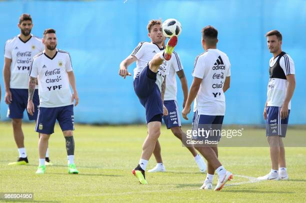 Lucas Biglia of Argentina and teammates warm up during a training session at Stadium of Syroyezhkin sports school on June 28 2018 in Bronnitsy Russia