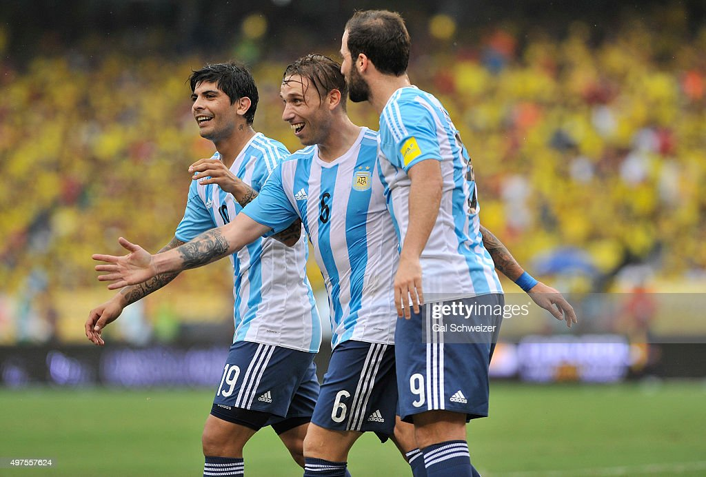 Lucas Biglia (C) of Argentina celebrates with teammates Gonzalo Higuain and Ever Banega after scoring the opening goal during a match between Colombia and Argentina as part of FIFA 2018 World Cup Qualifiers at Metropolitano Stadium on November 17, 2015 in Barranquilla, Colombia.