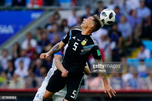 Lucas Biglia of Argentina goes for a header against Kári Árnason of Iceland during the 2018 FIFA World Cup Russia group D match between Argentina and...