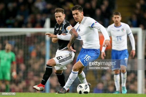 Lucas Biglia of Argentina Lorenzo Pellegrini of Italy during the International Friendly match between Italy v Argentina at the Etihad Stadium on...