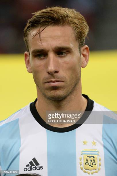 Lucas Biglia of Argentina poses before the start of their international friendly football match against Singapore at the National Stadium in...