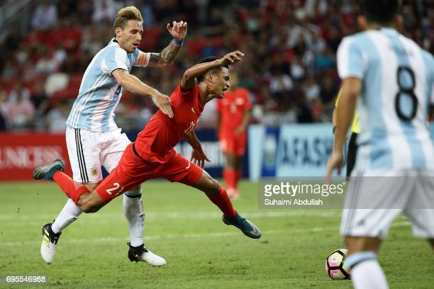 Lucas Biglia of Argentina tackles Safuwan Baharudin of Singapore during the International Test match between Argentina and Singapore at National...