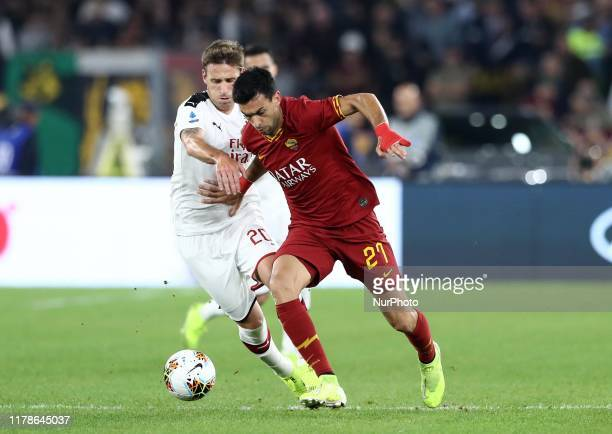 Lucas Biglia of Milan and Javier Pastore of Roma in action during the Serie A match AS Roma v Ac Milan at the Olimpico Stadium in Rome, Italy on...