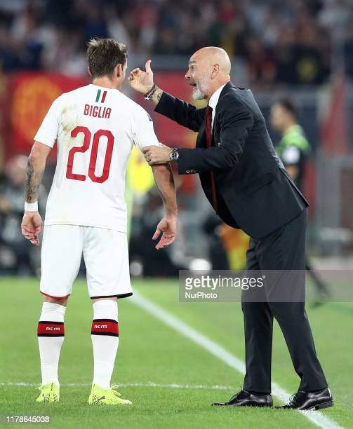 Lucas Biglia of Milan and Stefano Pioli manager of Milan during the Serie A match AS Roma v Ac Milan at the Olimpico Stadium in Rome, Italy on...