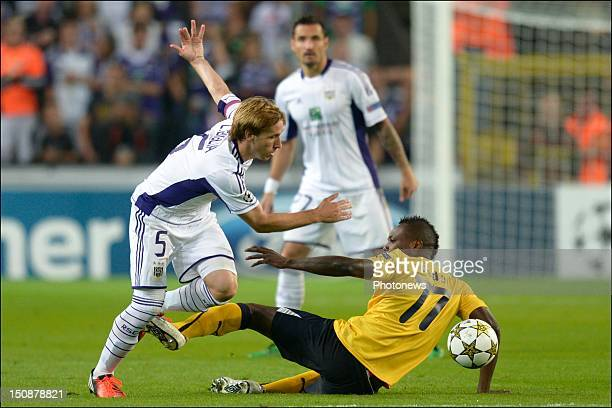 Lucas Biglia of RSC Anderlecht battles for the ball with Vouho of Limassol during the third qualifying round of the UEFA Champions League return...