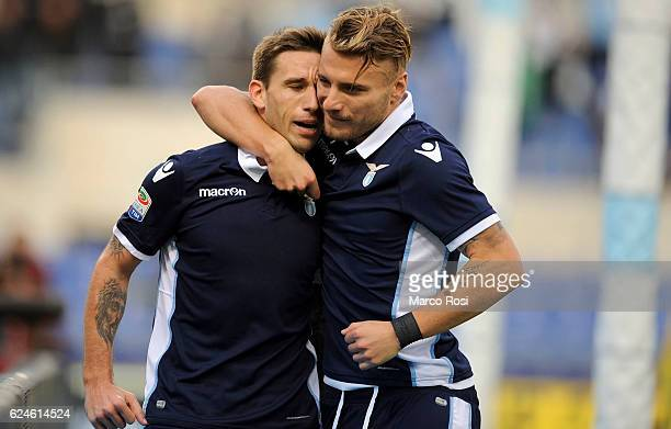 Lucas Biglia of SS Lazio celebrates with teammate Ciro Immobile after scoring his side's second goal from the penalty spot during the Serie A match...