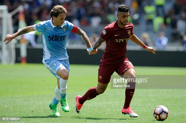 Lucas Biglia of SS Lazio compete for the ball with Emerson Palmieri of AS Roma during the Serie A match between AS Roma and SS Lazio at Stadio...