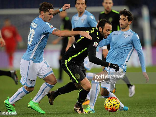 Lucas Biglia of SS Lazio competes for the ball with Giampaolo Pazzini of Hellas Verona FC during the Serie A match between SS Lazio and Hellas Verona...