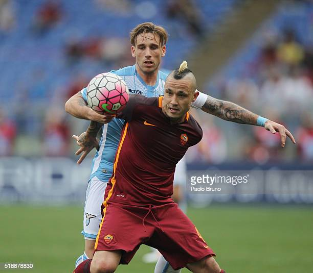 Lucas Biglia of SS Lazio competes for the ball with Radja Nainggolan of AS Roma during the Serie A match between SS Lazio and AS Roma at Stadio...