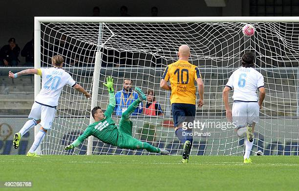 Lucas Biglia of SS Lazio scores his team's first goal from the penalty spot during the Serie A match between Hellas Verona FC and SS Lazio at Stadio...