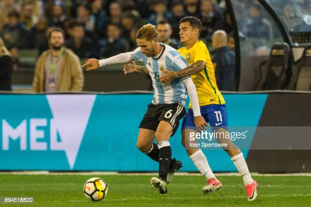 Lucas Biglia of the Argentinan National Football Team and Philippe Coutinho of the Brazilian National Football Team contest the ball during the...