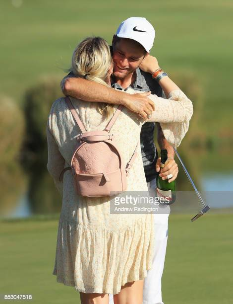 Lucas Bjerregaard of Denmark celebrates victory on the 18th green with Henriette Q Friis Ostergaard during day four of the Portugal Masters at Dom...
