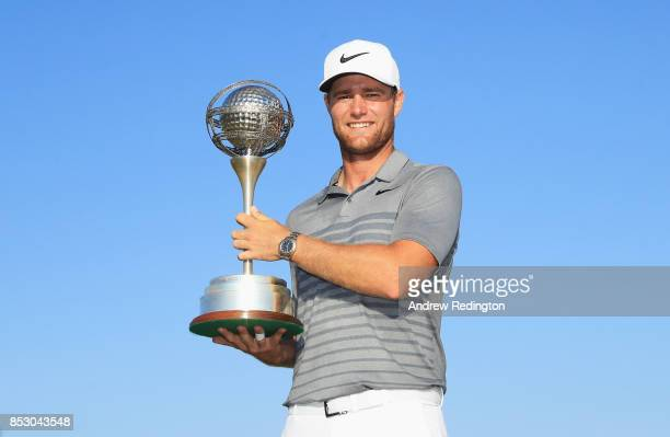 Lucas Bjerregaard of Denmark celebrates victory with the trophy during day four of the Portugal Masters at Dom Pedro Victoria Golf Club on September...
