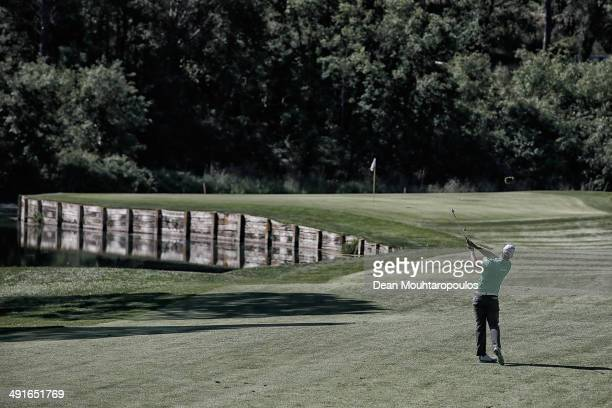 Lucas Bjerregaard of Denmark hits his third shot on the 3rd hole during Day 2 of the Open de Espana held at PGA Catalunya Resort on May 16 2014 in...