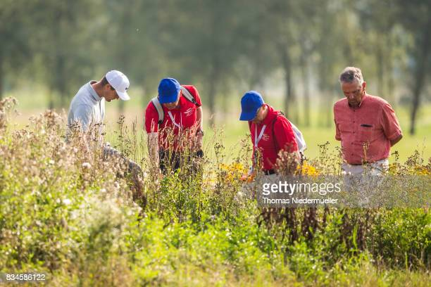 Lucas Bjerregaard of Denmark searches his ball during day two of the Saltire Energy Paul Lawrie Matchplay at Golf Resort Bad Griesbach on August 18...